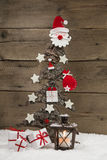 Classic christmas decoration in red and white: wooden tree. Royalty Free Stock Photo