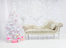 Classic Christmas light interior in white and pink tones with a couch