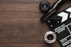 Classic clapperboard and lenses Royalty Free Stock Images
