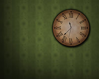 Classic clock. Hanging on an old wall Royalty Free Stock Photos