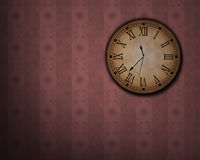 Classic clock. Hanging on an old wall Royalty Free Stock Images