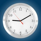Classic clock on blue Stock Photography