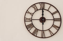 Classic clock. On raw concrete wall background Stock Photos