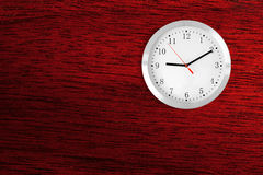 Classic clock on red wood background with copy-space Stock Photography