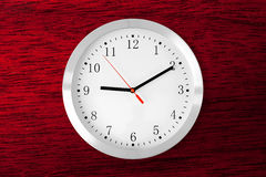 Classic clock on red wood background Stock Images