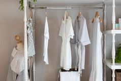 Classic closet style. With clothes hanging, white color tone wardrobe with clothes, interior decoration design concept royalty free stock image