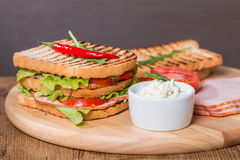 Classic club sandwich with bacon and vegetables Stock Image