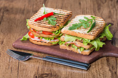 Classic club sandwich with bacon and vegetables Royalty Free Stock Images