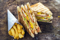 Classic Club Sandwich. On wooden background royalty free stock images