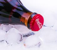 The Classic Coca-Cola bottle with ice. Chisinau, Moldova April - 03, 2017: The Classic Coca-Cola bottle with ice. Coca-Cola Company is the most popular market stock photography