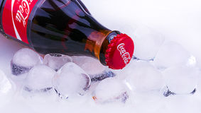 Classic Coca-Cola bottle with ice. Chisinau, Moldova April - 03, 2017:l Classic Coca-Cola bottle with ice. Coca-Cola Company is the most popular market leader in stock photography