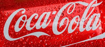 Classic Coca Cola can in water drops Royalty Free Stock Photos