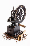 Classic Coffee Grinder with coffee beans. On white background Stock Images