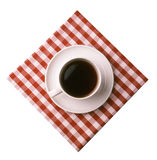 Classic Coffee Over White. Coffee cup and saucer on a checkered napkin, over white Royalty Free Stock Photo