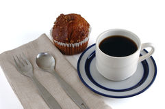 Classic Coffeecup w-muffin 1. Coffee cup with saucer, blue and white, isolated Stock Images