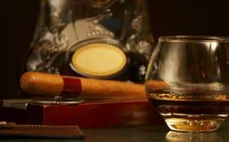 Classic cognac bottle, cigar Stock Images