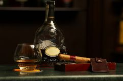 Classic cognac bottle, cigar Royalty Free Stock Image