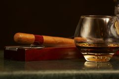 Classic cognac bottle, cigar Royalty Free Stock Photography