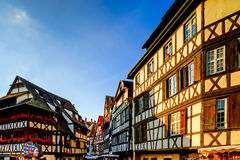 Classic colorized timber-framed alsacien houses in the street of Royalty Free Stock Image