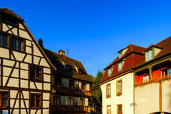Classic colorized timber-framed alsacien houses in the street of Stock Photos