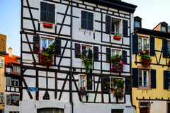 Classic colorized timber-framed alsacien houses in the street of Royalty Free Stock Images