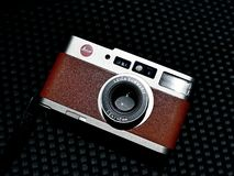 Retro compact Leica CM  close up shot with natural light. Classic compact Leica CM brown , with 35mm film technology never die because film photography wil never royalty free stock images