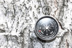 Classic compass on natural wooden background royalty free stock images