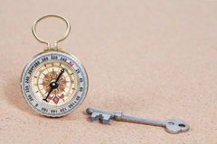 Classic compass and old key , shallow DOF Stock Photo
