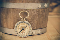 Classic Compass on a Wooden Table. Royalty Free Stock Photo