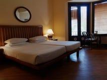 Classic Contemporary Bedroom. A classic contemporary hotel bedroom in a luxury spa villa stock image