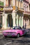 Classic convertible car driving tourists around Old Havana Stock Photo
