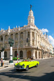 Classic convertible car next to the Great Theater of Havana. HAVANA,CUBA - JULY 14,2016 : Street scene with classic convertible car next to the Great Theater of stock image