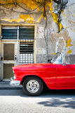 Classic convertible car next to a shabby building in Old Havana Stock Photography
