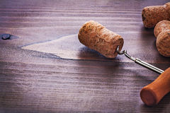Classic corkscrew twisted in cork of champagne on Royalty Free Stock Images