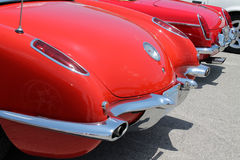 Classic corvette rearend. Rear view of classic red Chevrolet Corvette tailend deck. Corvette in a lineup at 2014 Memorial Day car show, Tamiami Airport, Miami Royalty Free Stock Image