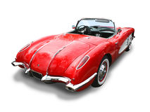 Classic Corvette Sports Car- isolated. Classic Corvette Sports Car 1958 Convertible- red with white coves. 3/4 rear view, over white with clipping path Royalty Free Stock Photography