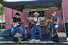 Classic Country Music by local Musicians. Clifton Forge, VA – June 3rd: Classic country musicians entertaining visitors at the annual Alleghany Highlands stock photography