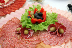 Classic Croatian starter plate with Fine Croatian sliced salami Royalty Free Stock Photo