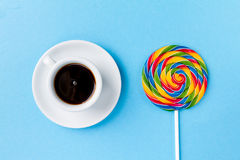 Classic cup coffee espresso with Candy Lollypop Breakfast on Bri. Tasty appetizing Party Accessory Sweet Treat Swirl Candy Lollypop with Coffee Espresso on Royalty Free Stock Image