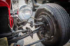 Classic customized retro vintage car wheel and brake component parts Royalty Free Stock Photo