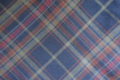 Classic dark plaid fabric from above. Classic dark plaid fabric directly from above Stock Photography