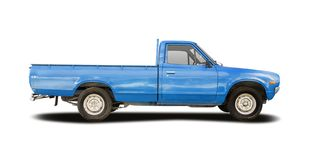 Classic Datsun pickup truck isolated on white. Classic Japanese blue pickup truck isolated on white stock images