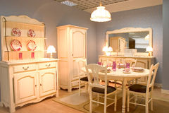 Classic dining room. Cassic dining room with wooden furniture and warm white tones stock photo