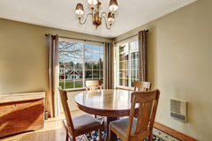 Classic dinning room with table chairs, and hardwood floor. Royalty Free Stock Photos