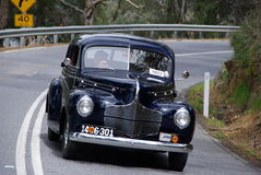 Classic Dodge car. The front of a classic black Dodge car as it cruises down the highway Royalty Free Stock Photos