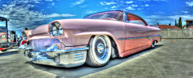 Classic 1960 Dodge. Custom painted pink 1960 Chrysler Dodge with white wall tires on display royalty free stock images