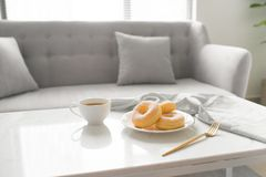 Classic donut. Morning breakfast on table in living room at home Royalty Free Stock Images
