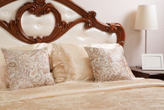 Classic double bed with wooden decor, stock photography