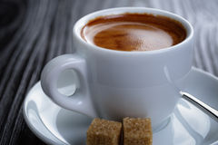 Classic double espresso on wood table Royalty Free Stock Photo