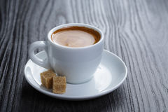 Classic double espresso on wood table Stock Image